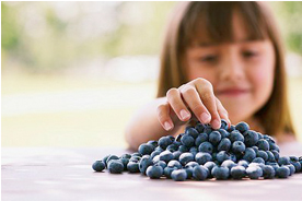 girl blueberries
